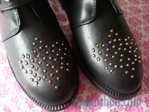 Tiny gold ball studs give a Western/rocker touch to the se otherwise classic boots.